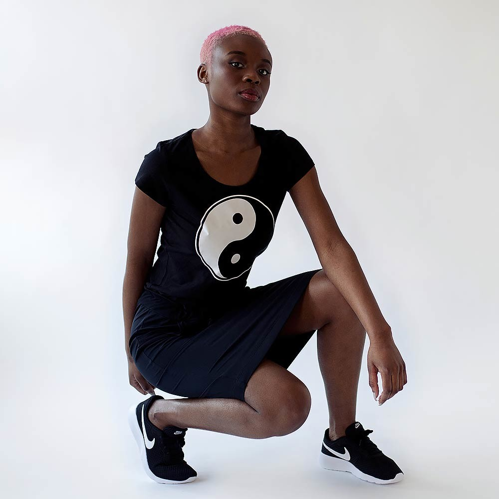 black skirt and black tee with ying-yang print