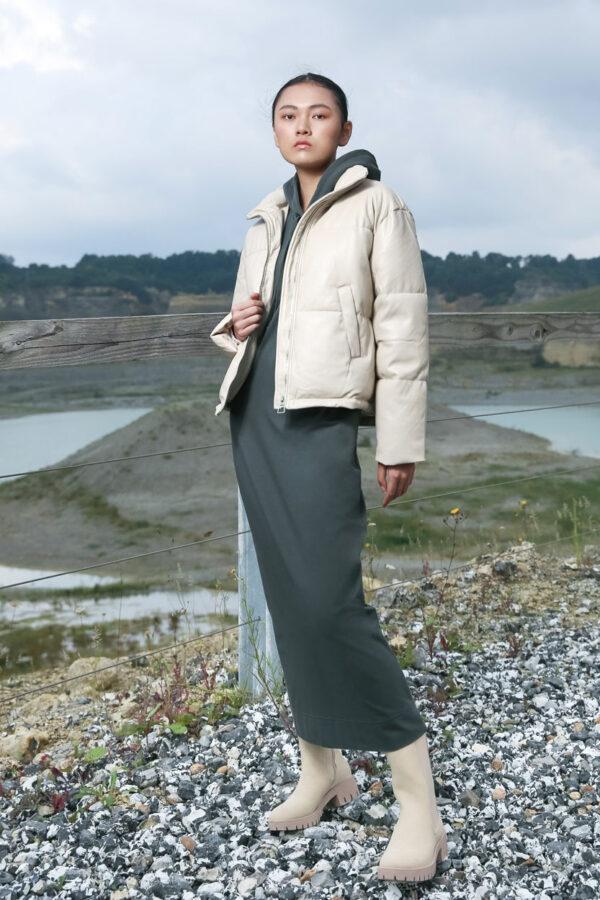 model in sand color short padded jacket