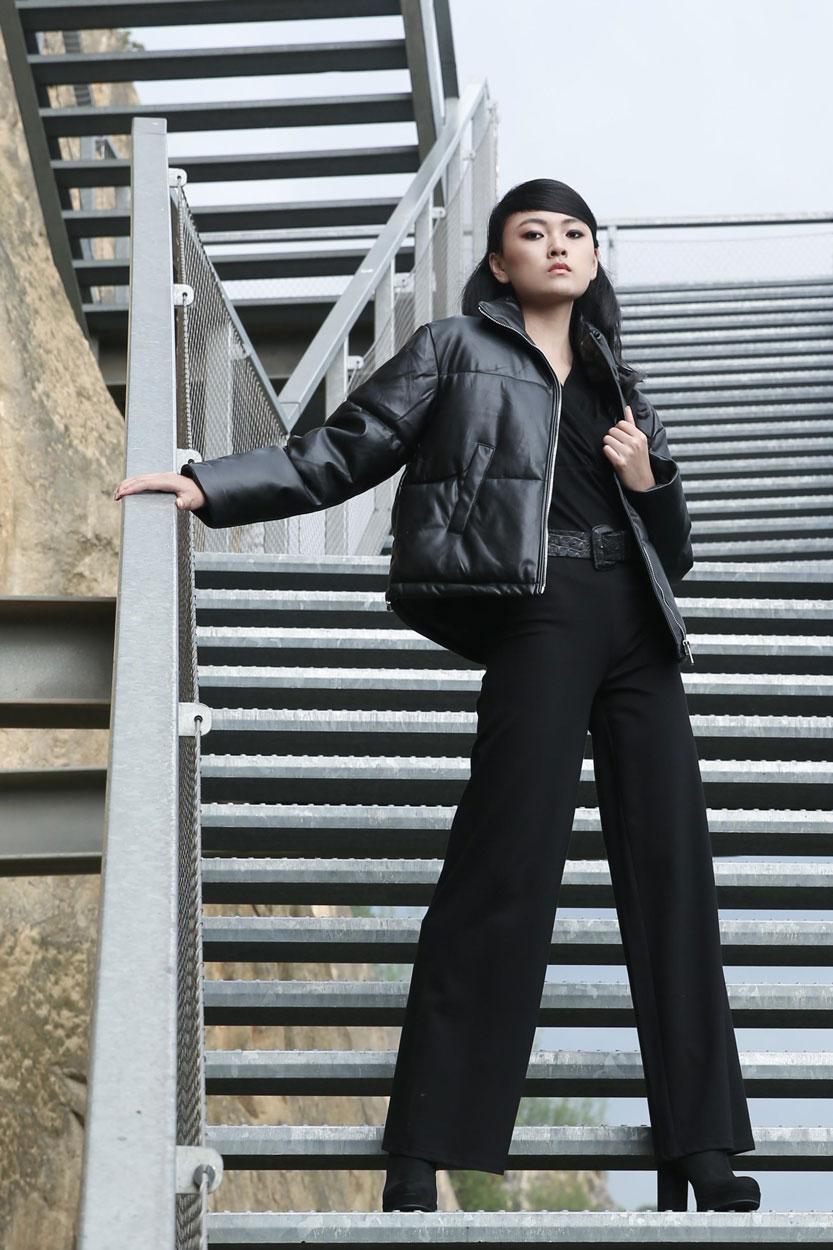 model in black short padded jacket
